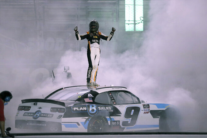 Noah Gragson (9) celebrates after winning a NASCAR Xfinity Series auto race at Bristol Motor Speedway Monday, June 1, 2020, in Bristol, Tenn. (AP Photo/Mark Humphrey)