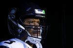 Seattle Seahawks' Russell Wilson waits to run onto the field before an NFL wild-card playoff football game against the Philadelphia Eagles, Sunday, Jan. 5, 2020, in Philadelphia. (AP Photo/Matt Rourke)