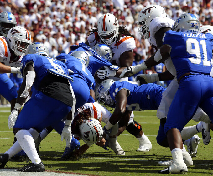 Virginia Tech quarterback Connor Blumrick, bottom, rushes for a touchdown in the first half of an NCAA college football game against Middle Tennessee, Saturday, Sept. 11, 2021, in Blacksburg Va.  (AP Photo/Matt Gentry)