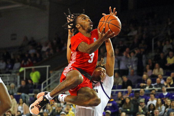 Houston's DeJon Jarreau (3) drives to the basket past East Carolina's Brandon Suggs (4) during the second half of an NCAA college basketball game in Greenville, N.C., Wednesday, Jan. 29, 2020. (AP Photo/Karl B DeBlaker)