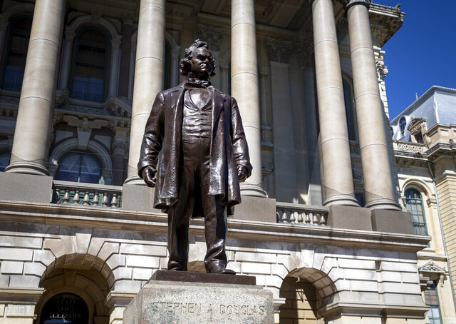 A statue of Stephen Douglas stands in front of the east entrance to the Illinois State Capitol, Wednesday, Aug. 19, 2020, in Springfield, Ill. Illinois officials approved Wednesday the removal of the statue of the 19th century senator from Illinois who owned slaves and espoused the notion that each territory should decide whether slavery would be allowed. (Justin L. Fowler/The State Journal-Register via AP)