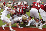 North Carolina State's Reggie Gallaspy II (25) scores a touchdown as State's Joshua Fedd-Jackson (66) blocks Boston College's Zach Allen (2) during the first half an NCAA college football game in Raleigh, N.C., Saturday, Oct. 6, 2018. (AP Photo/Gerry Broome)