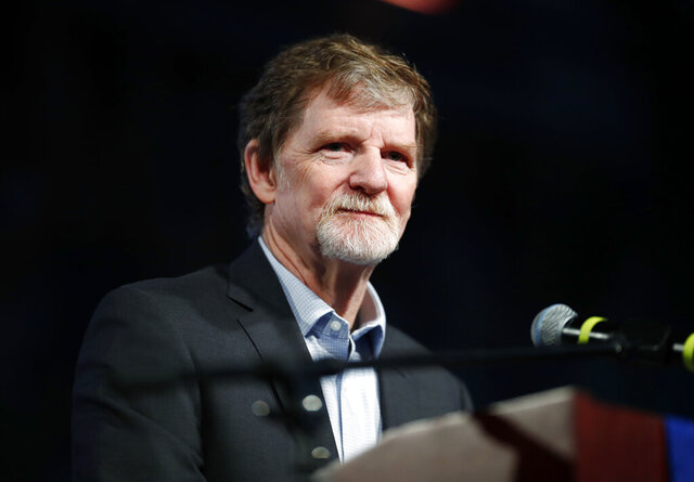FILE - This Nov. 8, 2017 file photo shows Jack Phillips, owner of Masterpiece Cake, during a rally in Lakewood, Colo. Phillips, the Colorado cake shop owner whose refusal to design a wedding cake for a same sex couple led to landmark Supreme Court ruling, has a book deal. Phillips' memoir, currently untitled, will be released this summer by Salem Books Publishing. (AP Photo/David Zalubowski, File)
