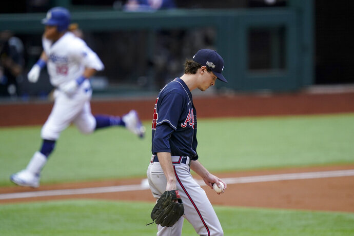 Los Angeles Dodgers' Justin Turner rounds the bases after a home run off Atlanta Braves starting pitcher Max Fried during the first inning in Game 6 of a baseball National League Championship Series Saturday, Oct. 17, 2020, in Arlington, Texas. (AP Photo/Eric Gay)
