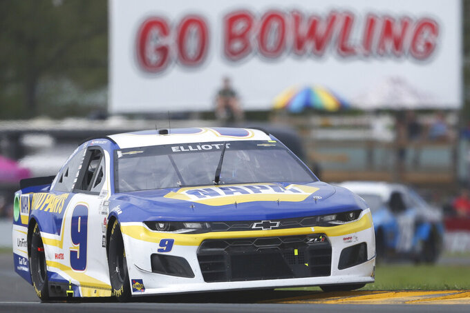 Chase Elliott drives through the Bus Stop during a NASCAR Cup Series auto race in Watkins Glen, N.Y., on Sunday, Aug. 8, 2021. (AP Photo/Joshua Bessex)