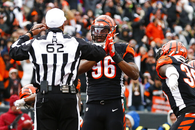 Cincinnati Bengals defensive end Carlos Dunlap (96) reacts as a safety is called by referee Ron Torbert (62) during the second half of an NFL football game, Sunday, Dec. 1, 2019, in Cincinnati. (AP Photo/Gary Landers)