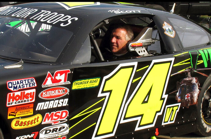 FILE - In this July 6, 2017 file photo, Vermont Gov. Phil Scott waits to take his stock car out for a practice run at the Thunder Road race track in Barre, Vt. A spokeswoman for Scott said the stock-car-racing governor is questioning whether to race in 2018 at the speedway where many spectators are hunters, after a public outcry over gun restriction legislation he signed on April 11, 2018. (AP Photo/Wilson Ring, File)