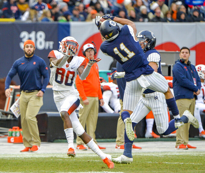 Notre Dame safety Alohi Gilman (11) steps in front of Syracuse wide receiver Taj Harris (80) for interception during the first half of an NCAA college football game, Saturday, Nov. 17, 2018, at Yankee Stadium in New York. (AP Photo/Howard Simmons)