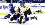 Boston Bruins defenseman Steven Kampfer (44) takes down Tampa Bay Lightning center Anthony Cirelli (71) during the second period of an NHL hockey game Monday, March 25, 2019, in Tampa, Fla. (AP Photo/Chris O'Meara)