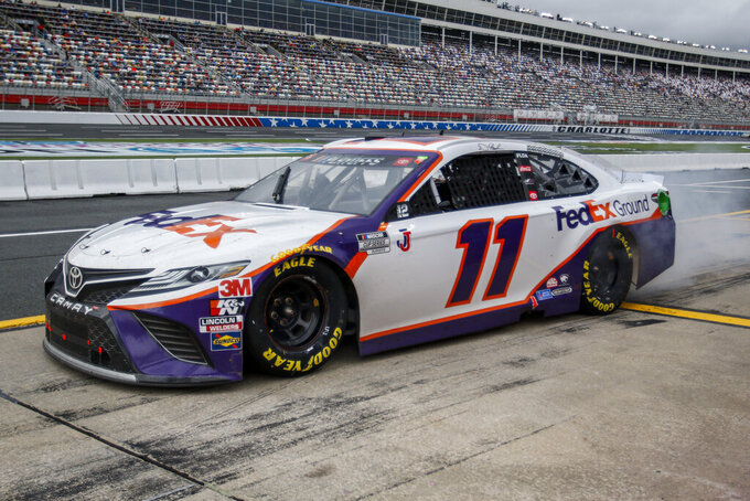 Denny Hamlin leaves his pit box after a pit stop in a NASCAR Cup Series auto race at Charlotte Motor Speedway in Concord, N.C., Sunday, Oct. 11, 2020. (AP Photo/Nell Redmond)