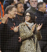 San Francisco Giants CEO Larry Baer and his wife, Pamela Baer, stand for the playing of