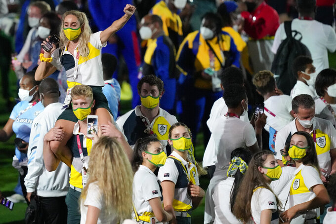Athletes from Australia enter the closing ceremony in the Olympic Stadium at the 2020 Summer Olympics, Sunday, Aug. 8, 2021, in Tokyo, Japan. (AP Photo/Aaron Favila)