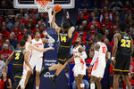 Virginia Commonwealth's Marcus Santos-Silva (14) shoots against Dayton's Trey Landers (3) during the first half of an NCAA college basketball game Tuesday, Jan. 14, 2020, in Dayton, Ohio. (AP Photo/John Minchillo)
