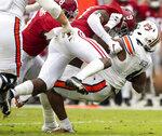 Alabama defensive back Jordan Battle (9) stops Alabama running back Tank Bigsby (4) during an NCAA college football game Saturday, Nov. 28, 2020, in Tuscaloosa, Ala. (Mickey Welsh/The Montgomery Advertiser via AP)