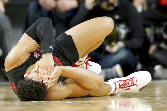 Houston Cougars guard Quentin Grimes (24) reacts after he is injured in the second half in the first half of an NCAA college basketball game, Saturday, Feb. 1, 2020, in Cincinnati. (Kareem Elgazzar/The Cincinnati Enquirer via AP)