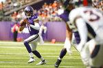 Minnesota Vikings quarterback Kellen Mond (11) throws a pass during the first half of an NFL preseason football game against the Denver Broncos, Saturday, Aug. 14, 2021, in Minneapolis. (AP Photo/Bruce Kluckhohn)