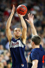Virginia's Francesco Badocchi shoots during a practice session for the semifinals of the Final Four NCAA college basketball tournament, Friday, April 5, 2019, in Minneapolis. (AP Photo/Charlie Neibergall)