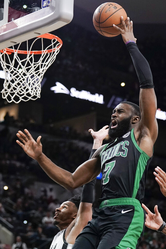 Boston Celtics' Jaylen Brown shoots during the second half of an NBA basketball game against the San Antonio Spurs, Saturday, Nov. 9, 2019, in San Antonio. (AP Photo/Darren Abate)