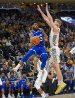 Seton Hall guard Myles Powell, left, passes the ball around Marquette forward Sam Hauser, right, during the second half of an NCAA college basketball game Saturday, Jan. 12, 2019, in Milwaukee. (AP Photo/Darren Hauck)