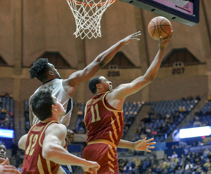 Iowa State guard Talen Horton-Tucker (11) goes to the basket while being defended by West Virginia forward Derek Culver (1) during the second half of an NCAA college basketball game Wednesday, March 6, 2019, in Morgantown, W.Va. (William Wotring/The Dominion-Post via AP)