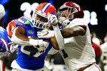 Florida running back Dameon Pierce (27) runs into the end zone for a touchdown against Alabama linebacker Ben Davis (1) during the second half of the Southeastern Conference championship NCAA college football game, Saturday, Dec. 19, 2020, in Atlanta. (AP Photo/Brynn Anderson)
