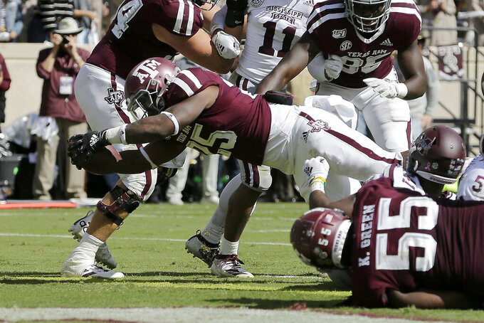Texas A&M running back Cordarrian Richardson (25) dives over the goal line for a touchdown against Mississippi State during the fourth quarter of an NCAA college football game, Saturday, Oct. 26, 2019, in College Station, Texas. (AP Photo/Sam Craft)