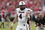 South Carolina quarterback Luke Doty (4) gestures to teammates before the team's NCAA college football game against Georgia on Saturday, Sept. 18, 2021, in Athens, Ga. (Joshua Boucher/The State via AP)