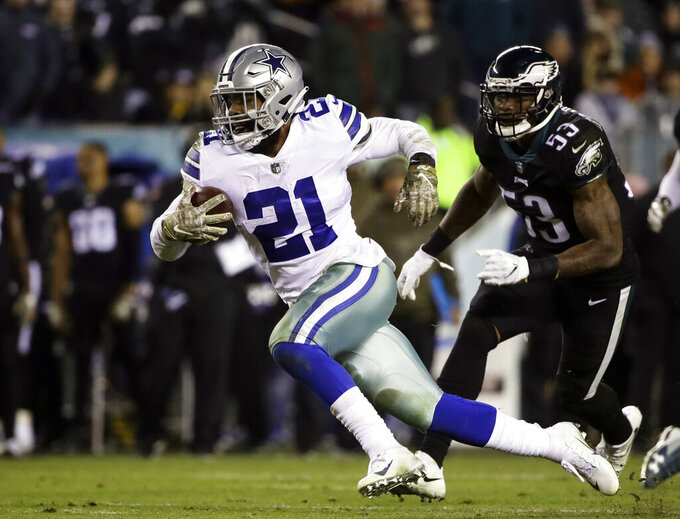 FILE - In this Nov. 11, 2018, file photo, Dallas Cowboys running back Ezekiel Elliott (21) runs against the Philadelphia Eagles during an NFL football game in Philadelphia. The Dallas Cowboys have picked up the fifth-year option on Ezekiel Elliott's rookie contract, keeping the star running back with the club at least through 2020. The two-time NFL rushing champion is set to make $3.9 million this season and $9.1 million in his fifth year unless Elliott and the team agree on a contract before then. The Cowboys have said they want a long-term deal with the fourth overall pick from the 2016 draft. (AP Photo/Matt Rourke, File)