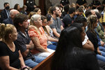 Friends and families of the victims listen during the plea hearing for spa shooting suspect Robert Aaron Long in Superior Court of Cherokee County in Canton, Ga. on Tuesday, July 27, 2021. The man accused of killing eight people, most of them women of Asian descent, at Atlanta-area massage businesses pleaded guilty to four of the murders. He was handed four sentences of life without parole. Robert Aaron Long still faces the death penalty in the four other deaths, which are being prosecuted in a different county. (Ben Gray/Atlanta Journal-Constitution via AP, Pool)
