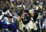 Colorado quarterback Steven Montez rolls out of the pocket for a short gain against Washington during the first half of an NCAA college football game Saturday, Nov. 23, 2019, in Boulder, Colo. (AP Photo/David Zalubowski)