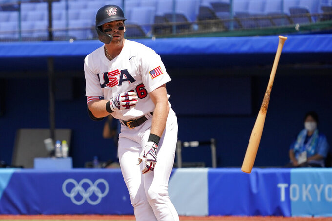 United States' Triston Casas (26) tosses his bat after a walk during a baseball game against the Dominican Republic at the 2020 Summer Olympics, Wednesday, Aug. 4, 2021, in Yokohama, Japan. (AP Photo/Sue Ogrocki)