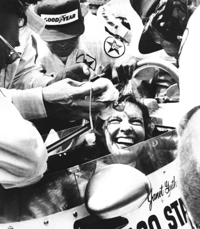 FILE - Janet Guthrie is all smiles as her pit crew swarms around her following her run in the Indy 500-mile race in Indianapolis, in this May 28, 1978, file photo. Janet Guthrie is still astonished at all the fan mail that pours in from around the world. And she's honored to hear that Academy Award winner Hilary Swank wants to portray her in a movie. Forty-four years after her history making run at the Indianapolis 500, Guthrie's impact on the growth of female sports is certainly a legacy worth remembering. (AP Photo/File)
