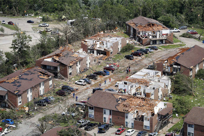 Severe storm damage is seen in Jefferson City, Mo., Thursday, May 23, 2019, after a tornado hit overnight. A tornado tore apart buildings in Missouri's capital city as part of an overnight outbreak of severe weather across the state. (AP Photo/Jeff Roberson)