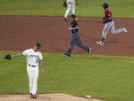 Pittsburgh Pirates relief pitcher Anthony Banda (52) awaits a new ball as Arizona Diamondbacks' Carson Kelly runs the bases behind him after hitting a pinch-hit home run during the seventh inning of a baseball game Wednesday, Aug. 25, 2021, in Pittsburgh. (AP Photo/Keith Srakocic)