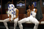 Duke guard Tre Jones, left, and forward Cam Reddish sit in the Duke locker room after an NCAA men's East Regional final college basketball game against Michigan State, Sunday, March 31, 2019, in Washington. Michigan State won 68-67. (AP Photo/Patrick Semansky)