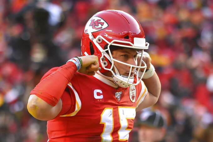 Kansas City Chiefs' Patrick Mahomes reacts after running for a touchdown during the first half of the NFL AFC Championship football game against the Tennessee Titans Sunday, Jan. 19, 2020, in Kansas City, MO. (AP Photo/Ed Zurga)