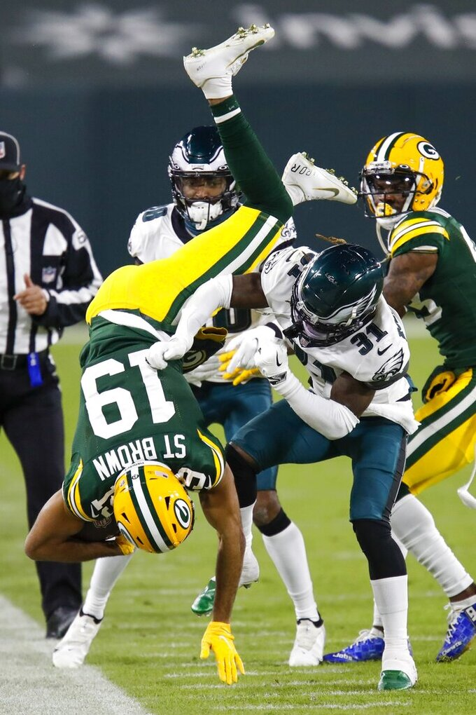 Philadelphia Eagles' Nickell Robey-Coleman tackles Green Bay Packers' Equanimeous St. Brown during the second half of an NFL football game Sunday, Dec. 6, 2020, in Green Bay, Wis. (AP Photo/Matt Ludtke)