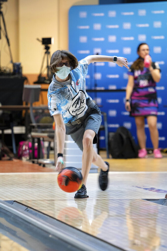 """Critical care nurse and professional bowler Erin McCarthy competes at the 2021 PWBA Kickoff Classic Series in Arlington, Texas, on Jan. 21, 2021. """"You have to have a calm demeanor and think clearly,"""" McCarthy says. """"I think that's probably why I love doing them both equally as much."""" (USBC via AP)"""