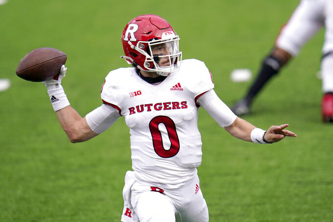 Rutgers quarterback Noah Vedral throws a pass against Maryland during the first half of an NCAA college football game, Saturday, Dec. 12, 2020, in College Park, Md. (AP Photo/Julio Cortez)