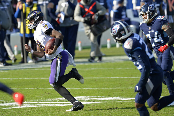 Baltimore Ravens quarterback Lamar Jackson (8) runs 48 yards for a touchdown against the Tennessee Titans in the first half of an NFL wild-card playoff football game Sunday, Jan. 10, 2021, in Nashville, Tenn. (AP Photo/Mark Zaleski)