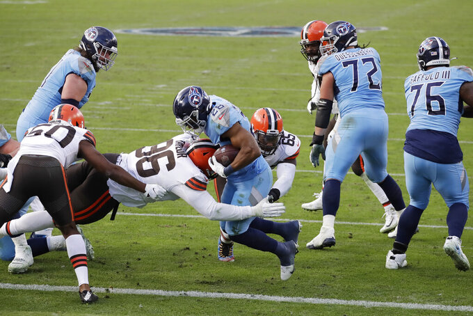 Tennessee Titans running back Jeremy McNichols (28) scores a touchdown past Cleveland Browns defensive tackle Vincent Taylor (96) in the second half of an NFL football game Sunday, Dec. 6, 2020, in Nashville, Tenn. (AP Photo/Ben Margot)