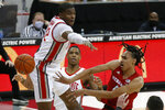 Nebraska's Dalano Banton, right, passes the ball past Ohio State's E.J. Liddell, left, and Eugene Brown during the first half of an NCAA college basketball game Wednesday, Dec. 30, 2020, in Columbus, Ohio. (AP Photo/Jay LaPrete)