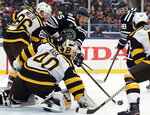 Chicago Blackhawks center Artem Anisimov (15) shoots against Boston Bruins goalie Tuukka Rask (40) and defenseman Kevan Miller (86) in the second period of the NHL Winter Classic hockey game at Notre Dame Stadium, Tuesday, Jan. 1, 2019, in South Bend, Ind. (AP Photo/Nam Y. Huh)