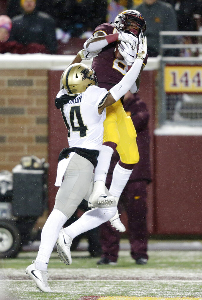 Minnesota wide receiver Tyler Johnson (6) catches a touchdown in front of Purdue cornerback Antonio Blackman (14) during the fourth quarter against Purdue in a NCAA college football game Saturday, Nov. 10, 2018, in Minneapolis. (AP Photo/Andy Clayton-King)