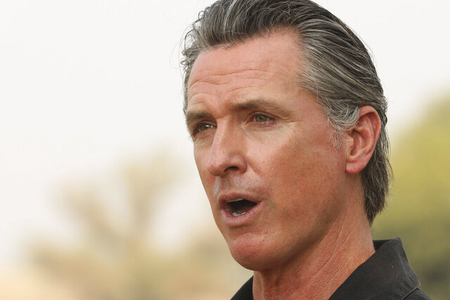 FILE - In this Sept. 14, 2020, file photo, California Gov. Gavin Newsom visits the Camelot Equestrian Park in Oroville, Calif. On Friday, Sept. 18, 2020, Gov. Newsom signed a law that makes more immigrants eligible for a tax credit. In June, California expanded the tax credit to immigrants who have jobs and pay taxes but don't have Social Security numbers. The law Newsom signed on Friday eliminates the requirement that immigrants must have children under the age of 6 to be eligible for the credit. (Carin Dorghalli/Bay Area News Group via AP, File)