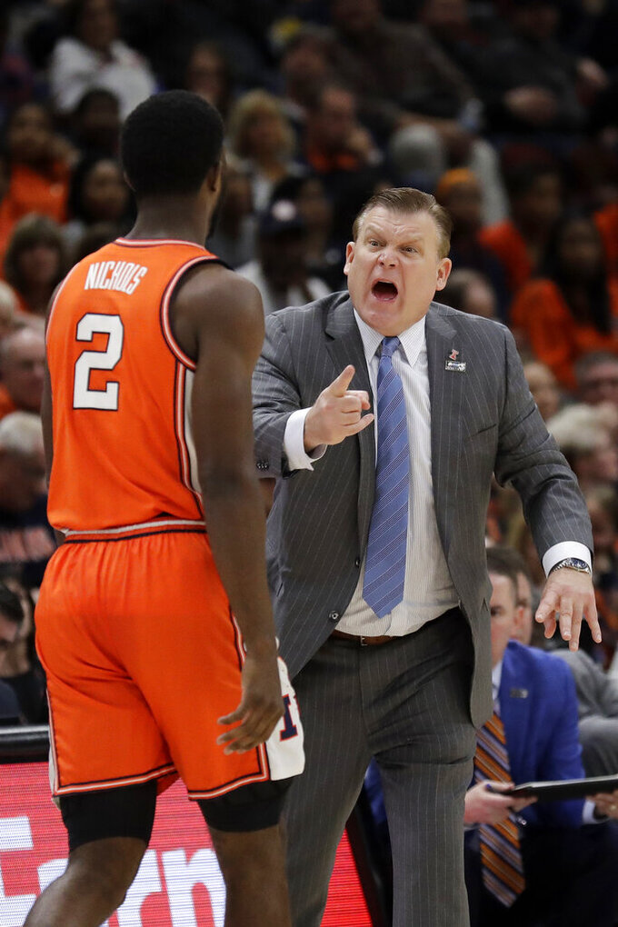 Illinois head coach Brad Underwood talks to Kipper Nichols (2) during the first half of an NCAA college basketball game against the Iowa in the second round of the Big Ten Conference tournament, Thursday, March 14, 2019, in Chicago. (AP Photo/Nam Y. Huh)