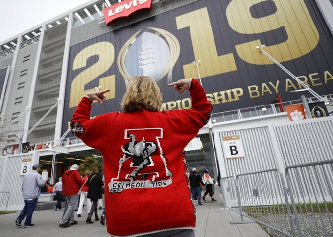 Sonya Snyder makes her way to Levi's Stadium before the NCAA college football playoff championship game between Alabama and Clemson Monday, Jan. 7, 2019, in Santa Clara, Calif. (AP Photo/David J. Phillip)