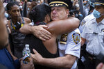 Chief of Department of the New York City Police, Terence Monahan, hugs an activist as protesters paused while walking in New York, Monday, June 1, 2020. Demonstrators took to the streets of New York to protest the death of George Floyd, who died May 25 after he was pinned at the neck by a Minneapolis police officer. (AP Photo/Craig Ruttle)