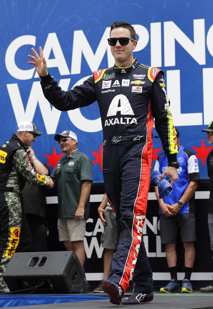Alex Bowman waves to the crowd during driver introductions before a NASCAR Cup Series auto race at Chicagoland Speedway in Joliet, Ill., Sunday, June 30, 2019. (AP Photo/Nam Y. Huh)