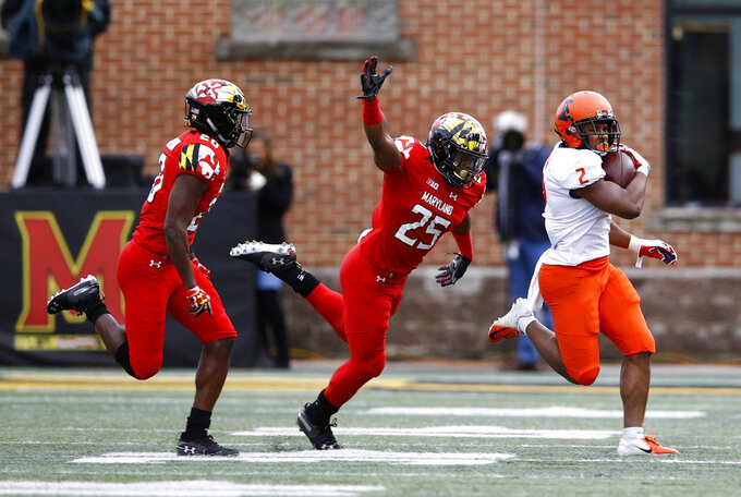 Maryland defensive backs Antwaine Richardson, left, and Antoine Brooks Jr. chase after Illinois running back Reggie Corbin as he rushes the ball in the first half of an NCAA college football game, Saturday, Oct. 27, 2018, in College Park, Md. (AP Photo/Patrick Semansky)